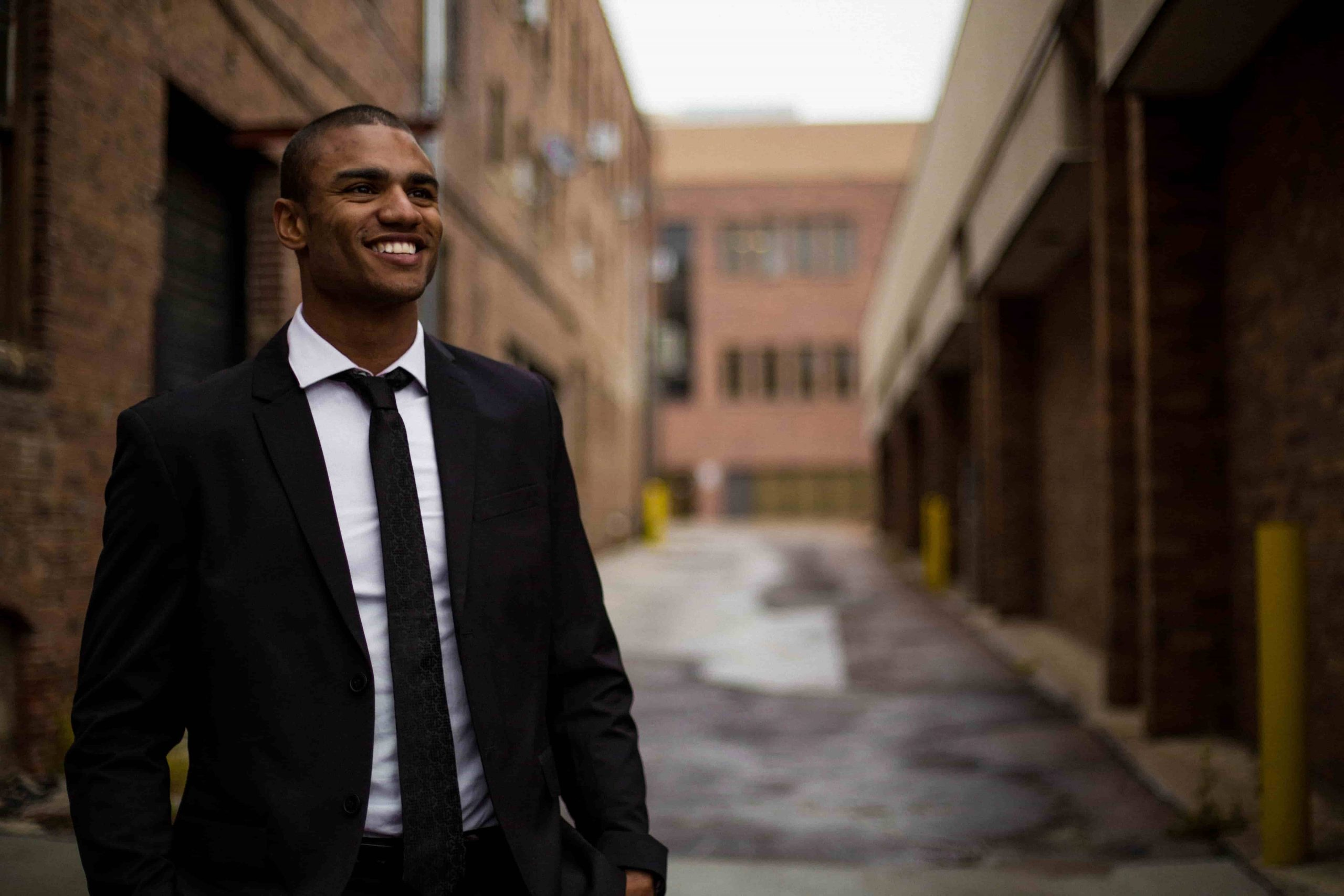 Headshot Photography Mistakes; man wearing a black suit posing for a picture