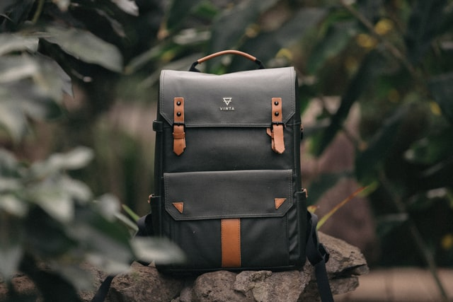 Common product shots; a stylish black and brown bag placed aesthetically over rocks for a picture